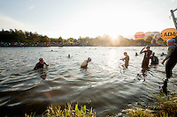 Professional triathletes enter the water just before 6.30 am for the first swim start of the Challenge Roth Ironman Triathlon, Roth, Germany, 10 July 2011