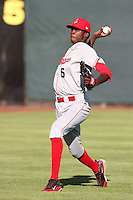 Spokane Indians pitcher Santo Perez #6 warms up before pitching against the Salem-Keizer Volcanoes at Volcanoes Stadium on August 10, 2011 in Salem-Keizer,Oregon. Salem-Keizer defeated Spokane 7-6.(Larry Goren/Four Seam Images)