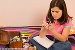 10 year old girl  looking at rock collection using magnifiying glass