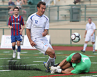 Evan Bush #1 of Crystal Palace Baltimore misses a shot by Eduardo Sebrano #12 of the Montreal Impact during an NASL match at Paul Angelo Russo Stadium in Towson, Maryland on August 21 2010. Montreal won 5-0.
