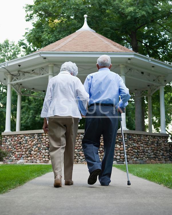 USA, Illinois, Metamora, Rear view of senior couple walking in park