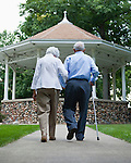 USA, Illinois, Metamora, Rear view of senior couple walking in park