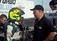 Jan. 2000; Chandler, AZ, USA; NHRA top fuel dragster driver Cory McClenathan (left) talks to crew chief Wes Cerney during pre season testing at Firebird International Raceway. Mandatory Credit: Mark J. Rebilas-