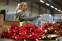 Pictured: A worker on the factory floor. Thursday 16 November 2017<br /> Re: Festive company which manufactures tinsel in Cwmbran, Wales, UK.