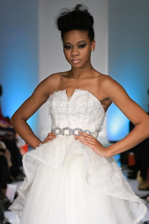 Model walks runway in a gown from Pantora by Andrea Bridal fall 2013 collection by Andrea Pitter, during BK Fashion Weekend Spring Summer 2013, September 30, 2012.