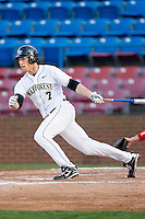 Mac Williamson #7 of the Wake Forest Demon Deacons follows through on his swing against the North Carolina State Wolfpack at Wake Forest Baseball Park March 19, 2010, in Winston-Salem, North Carolina.  Photo by Brian Westerholt / Four Seam Images