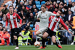 Real Madrid's Luka Modric and Athletic Club de Bilbao's Benat Etxeberria during La Liga match between Real Madrid and Athletic Club de Bilbao at Santiago Bernabeu Stadium in Madrid, Spain. April 21, 2019. (ALTERPHOTOS/A. Perez Meca)