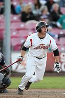 Salem-Keizer catcher Mike Murray #25 bats against the Eugene Emeralds at Volcanoes Stadium on August 9, 2011 in Salem-Keizer,Oregon. Eugene defeated Salem-Keizer 13-7.(Larry Goren/Four Seam Images)