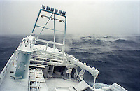 """Ice fog accompanies the fishing vessel """"Kiska Sea"""" as it fishes for opilio crab in the Bering Sea in January and February of 1995.  The Bering Sea is known for having the worst storms in the world. Ice fog is formed when the air is colder than the water. The boat is covered in ice from sea spray coming over the sides.  Crab fishing in the Bering Sea is considered to be one of the most dangerous jobs in the world.  This fishery is managed by the Alaska Department of Fish and Game and is a sustainable fishery.  The Discovery Channel produced a TV series called """"The Deadliest Catch"""" which popularized this fishery."""