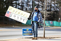 ATLANTA, GA - JANUARY 5: View of a person holding a sign during the Georgia Senate runoff races on January 5, 2021 in Atlanta, Georgia. <br /> CAP/MP34<br /> ©MPI34/Capital Pictures