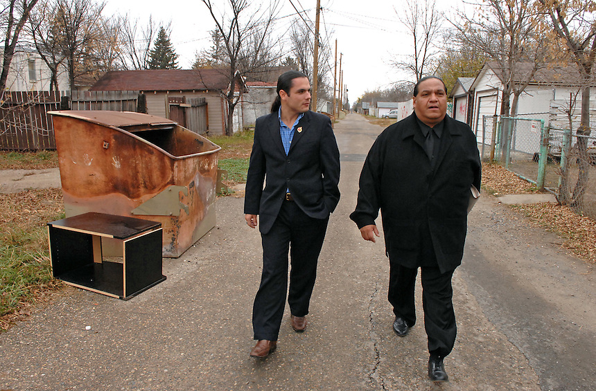 """Congress of Aboriginal Peoples (CAP) president Patrick Brazeau, left, takes a stroll down a North Central alley with anti-gang advocate Kevin """"Kubby"""" Daniels. """"You wouldn't want to walk down this alley at night,"""" Daniels told Brazeau. Brazeau went on to become the youngest member of the Canadian Senate, was suspended for expense fraud, plead guilty to assault and cocaine possession charges, and then recently returned to the Senate. MARK TAYLOR GALLERY"""