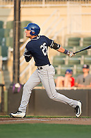 Sam Hilliard (25) of the Asheville Tourists follows through on his swing against the Kannapolis Intimidators at Kannapolis Intimidators Stadium on May 26, 2016 in Kannapolis, North Carolina.  The Tourists defeated the Intimidators 9-6 in 11 innings.  (Brian Westerholt/Four Seam Images)