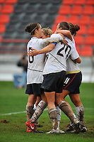 Abby Wambach, Lauren Cheney, Carli Lloyd and Amy Rodriguez celebrate following Wambach's game winning goal for the USA.  The USA defeated Norway 2-1 at Olhao Stadium on February 26, 2010 at the Algarve Cup.
