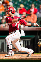Matt Reynolds #5 of the Arkansas Razorbacks follows through on his swing against the Texas Longhorns at Minute Maid Park on March 4, 2012 in Houston, Texas.  The Razorbacks defeated the Longhorns 7-3.  Brian Westerholt / Four Seam Images