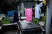 Clothes are left to dry at the Manila North Cemetery in Manila, Philippines. The scarcity of land and ever growing population has led the local filipinos to live in the same space around the graveyards in the Cemetary. Photo: Sanjit Das