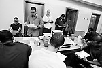BEACON, NEW YORK:  Carl Rothe goes over the test answers with the prisoners in The Puppies Behind Bars Program at Fishkill Correctional Facility. The class work for the program involves studying anatomy and general understanding of dog training and behavior.