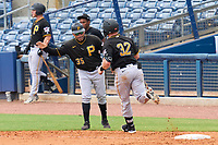 FCL Pirates Black manager Stephen Morales (35) congratulates Henry Davis (32) after hitting a two run home run, the first of his professional career, to opposite field in the top of the fourth inning during a game against the FCL Rays on August 3, 2021 at Charlotte Sports Park in Port Charlotte, Florida.  Davis was making his professional debut after being selected first overall in the MLB Draft out of Louisville by the Pittsburgh Pirates.  (Mike Janes/Four Seam Images)
