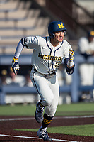 Michigan Wolverines outfielder Tito Flores (22) runs to first base during the NCAA baseball game against the Illinois Fighting Illini at Fisher Stadium on March 19, 2021 in Ann Arbor, Michigan. Illinois won the game 7-4. (Andrew Woolley/Four Seam Images)