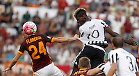 Calcio, Serie A: Roma vs Juventus. Roma, stadio Olimpico, 30 agosto 2015.<br /> Roma's Alessandro Florenzi, left, and Juventus' Paul Pogba jump for the ball during the Italian Serie A football match between Roma and Juventus at Rome's Olympic stadium, 30 August 2015.<br /> UPDATE IMAGES PRESS/Isabella Bonotto
