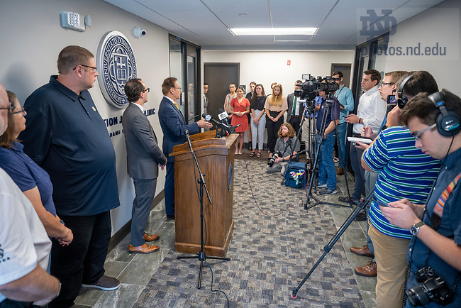 July 21, 2021; Notre Dame Professor of Law, Jimmy Gurule and attorney Elliot Slosar speak at a press conference to announce the exoneration of Andrew Royer (on their right) at the Exoneration Justice Clinic in South Bend. Accompanying Royer is his mother Jeannie and stepfather Mike Pennington. Royer is the clinic's first exoneree. His murder charge from 2002 was dismissed this week.  (Photo by Barbara Johnston/University of Notre Dame)