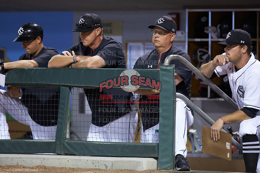 South Carolina Gamecocks head coach Mark Kingston and director of baseball development Trip Couch look on from the dugout against the North Carolina Tar Heels at BB&T BallPark on April 3, 2018 in Charlotte, North Carolina. The Tar Heels defeated the Gamecocks 11-3. (Brian Westerholt/Four Seam Images)