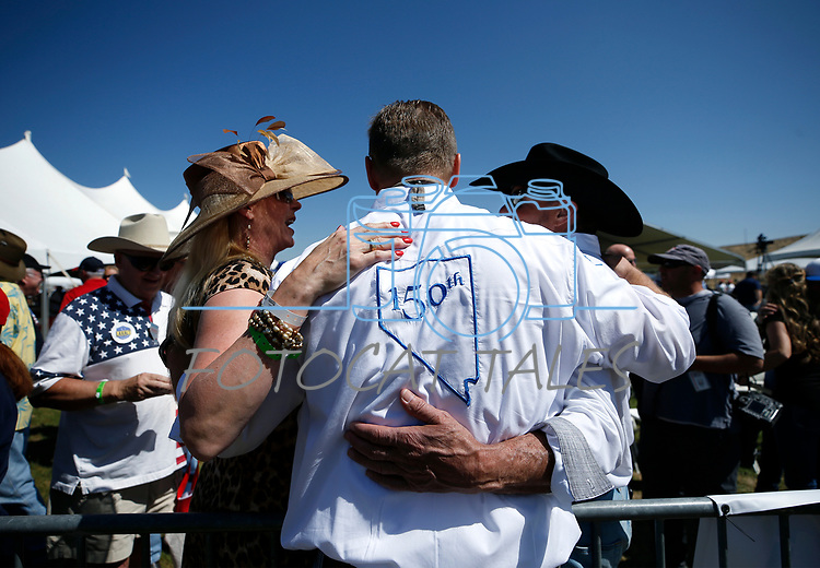 U.S. Sen. Dean Heller, center, visits with supporters at the 4th annual Basque Fry in Gardnerville, Nev., on Saturday, Aug. 25, 2018. Hosted by the Morning in Nevada PAC, the event is a fundraiser for conservative candidates and issues and includes traditional Basque dishes like deep-fried lamb testicles.(Cathleen Allison/Las Vegas Review Journal)