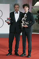 """Director Paolo Sorrentino poses with the Silver Lion Grand Jury Prize for """"The Hand Of God"""" and Filippo Scotti poses with the Marcello Mastroianni Award for Best New Young Actor for """"The Hand Of God"""" during the Winners Red Carpet as part of the 78th Venice International Film Festival in Venice, Italy on September 11, 2021. <br /> CAP/MPI/IS/PAC<br /> ©PAP/IS/MPI/Capital Pictures"""