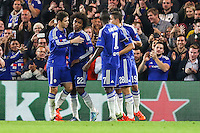 Willian of Chelsea (2nd left) celebrates the opening goal with team mates Aleksandar Dragovic of Dynamo Kyiv (not shown) turns his shot into his own net to make it 1-0 during the UEFA Champions League Group match between Chelsea and Dynamo Kyiv at Stamford Bridge, London, England on 4 November 2015. Photo by David Horn.