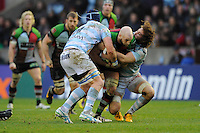 George Robson of Harlequins is tackled by Bernard Le Roux (left) and Camille Gerondeau of Racing Metro 92 during the Heineken Cup match between Harlequins and Racing Metro 92 at the Twickenham Stoop on Sunday 15th December 2013 (Photo by Rob Munro)