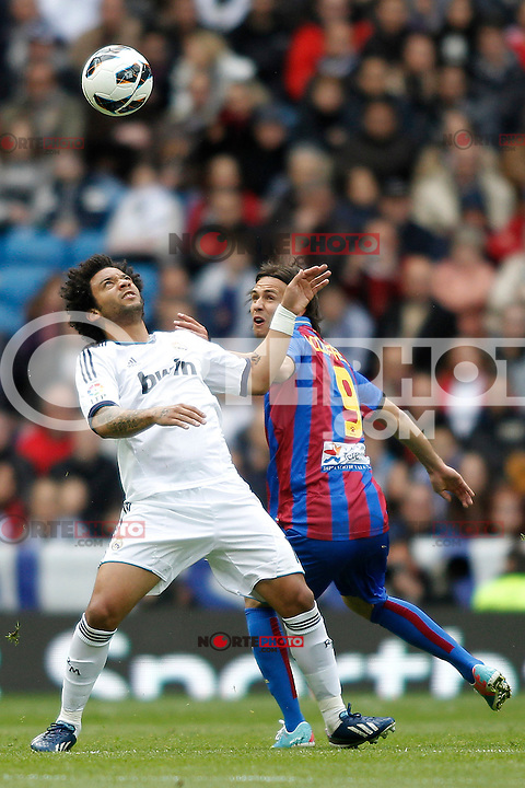 Real Madrid's Marcelo Vieira and Levante's Acquafresca during La Liga BBVA match. April 6, 2013.(ALTERPHOTOS/Alconada)