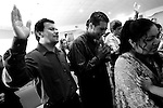 Salt Lake City, UT--8/27/06--&#xA;While singing praise songs, Victor and Augustine Jimenez become emotional during the Spanish-speaking worship service held at the Christian Life Center.<br />