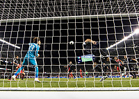 CHICAGO, IL - JULY 7: A header by Jordan Morris #11 goes towards the goal as Guillermo Ochoa #13 watches and Andres Guardado #18 heads the ball during a game between Mexico and USMNT at Soldier Field on July 7, 2019 in Chicago, Illinois.