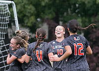 Newton, Massachusetts - October 25, 2015: NCAA Division I. In overtime, Boston College (gold) defeated University of Miami (charcoal gray), 5-4, at Newton Campus Soccer Field. <br /> Goal celebration.