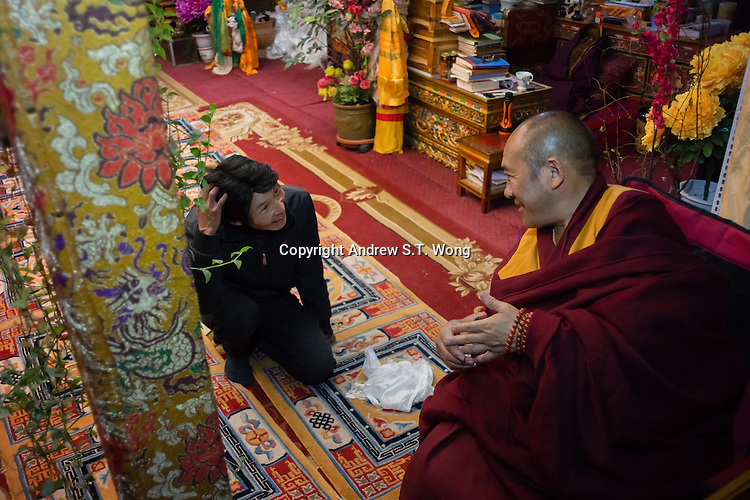 A senior monk greets a follower at Menri Monastery, which is located 4,700 metres above sea level, in Namling county, Tibet, China, 2015. Menri is a leading Bon monastery in Tibet. The original Bon (Yungdrung Bon) was founded around 16,000 BC,  according to the followers who are called Bonpo. Today, Bon can be found in the more isolated parts of northern and western Tibet. According to the Chinese census, about 10% of Tibetans (about 100,000 people) follow Bon.