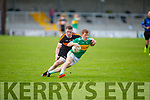 Mitchels Alan O'Donoghue been tackled by Austin Stacks Gerg Horan in the Tralee Town Board Senior Football Championship final.