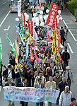 """May 1, 2013, Tokyo, Japan - Carrying union banners and hand-made signs bearing such words as """"Stop"""" and """"No,"""" participants in a May Day rally take to the streets of Tokyo in a peaceful demonstration on Wednesday, May 1, 2013. Some 32,000 people took part in the rally, voicing their concerns for tax hike and constitutional revision among other things.  (Photo by Natsuki Sakai/AFLO)"""