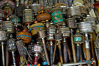 Hundreds and Hundreds of used and antique prayer wheels a for sale in the famous Barkhor street, Lhasa, Tibet