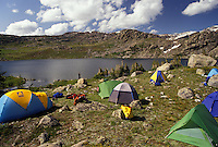 AJ3554, tent, camping, Bighorn Mountains, Bighorn National Forest, Wyoming, backpacking, Tents set up to camp for the night next to Lake Mistymoon in the Cloud Peak Wilderness Area in Bighorn National Forest in the state of Wyoming.