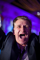 """Moscow, Russia, 25/09/2010..Russian fans cheer  gastroenterologist Doctor Fedor Rytikov as he performs Puccini's aria """"Nessun Dorma"""" in the finals of the Karaoke World Championships 2010, where amateur singers from around the world competed for prizes that included one million Russian dumplings."""