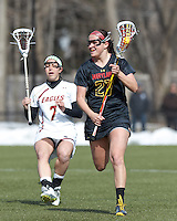 University of Maryland defender Shanna Brady (27) brings the ball forward. .University of Maryland (black) defeated Boston College (white), 13-5, on the Newton Campus Lacrosse Field at Boston College, on March 16, 2013.