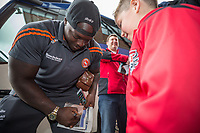Adebayo Akinfenwa of Wycombe Wanderers signs autographs on arriving at Vale Park ahead of the Sky Bet League 2 match between Port Vale and Wycombe Wanderers at Vale Park, Burslem, England on 12 August 2017. Photo by David Horn.