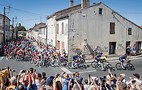 peloton rolling through town<br /> <br /> Stage 11 from Châtelaillon-Plage to Poitiers (168km)<br /> <br /> 107th Tour de France 2020 (2.UWT)<br /> (the 'postponed edition' held in september)<br /> <br /> ©kramon
