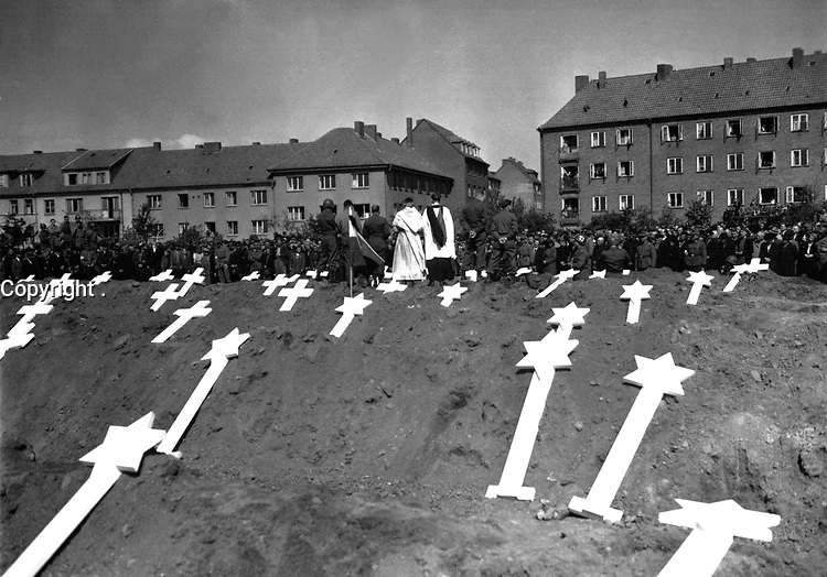 These markers are for the graves of 80 victims of the Nazis found in Ludwigslust.  The entire population of Schwerin, Germany, was ordered by the Military Government to attend fureral rites conducted by U.S. Army chaplains.  May 8, 1945.  A. Drummond, Jr. (Army)<br /> NARA FILE #:  111-SC-206611<br /> WAR & CONFLICT BOOK #:  1128