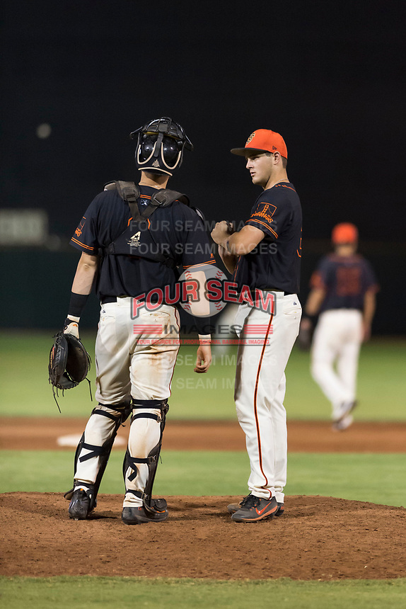 AZL Giants Black relief pitcher Cooper Casad (62) talks to catcher Cody Brickhouse (6) between innings of an Arizona League game against the AZL Rangers at Scottsdale Stadium on August 4, 2018 in Scottsdale, Arizona. The AZL Giants Black defeated the AZL Rangers by a score of 6-3 in the second game of a doubleheader. (Zachary Lucy/Four Seam Images)