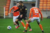 Milton Keynes Dons' Carlton Morris under pressure from Blackpool's Oliver Turton and Grant Ward<br /> <br /> Photographer Kevin Barnes/CameraSport<br /> <br /> The EFL Sky Bet League One - Blackpool v Milton Keynes Dons - Saturday 24 October 2020 - Bloomfield Road - Blackpool<br /> <br /> World Copyright © 2020 CameraSport. All rights reserved. 43 Linden Ave. Countesthorpe. Leicester. England. LE8 5PG - Tel: +44 (0) 116 277 4147 - admin@camerasport.com - www.camerasport.com