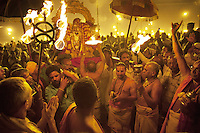 India. Uttar Pradesh state. Allahabad. Maha Kumbh Mela. A group of Indian Hindu devotees celebrate at night a puja on the banks in Sangam. Puja (reverence, honour, adoration, or worship) is a religious ritual performed by Hindus as an offering to various deities. The Kumbh Mela, believed to be the largest religious gathering is held every 12 years on the banks of the 'Sangam'- the confluence of the holy rivers Ganga, Yamuna and the mythical Saraswati. The belief is that bathing and taking a holy dip will wash and free one from all the past sins, get salvation and paves the way for Moksha (meaning liberation from the cycle of Life, Death and Rebirth). Bathing in the holy waters of Ganga is believed to be most auspicious at the time of Kumbh Mela, because the water is charged with positive healing effects and enhanced with electromagnetic radiations of the Sun, Moon and Jupiter. The Maha (great) Kumbh Mela, which comes after 12 Purna Kumbh Mela, or 144 years, is always held at Allahabad. Uttar Pradesh (abbreviated U.P.) is a state located in northern India. 12.02.13 © 2013 Didier Ruef