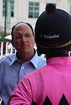 September 06, 2014:   Wayne Catalano and Shaun Bridgmohan, trainer and rider of Flashback, after the Ack Ack Handicap at Churchill Downs.  Owner Gary and Mary West. ©Mary M. Meek/ESW/CSM