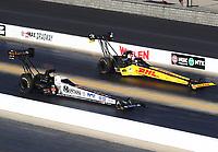 Oct 14, 2019; Concord, NC, USA; NHRA top fuel driver Austin Prock (left) alongside Richie Crampton during the Carolina Nationals at zMax Dragway. Mandatory Credit: Mark J. Rebilas-USA TODAY Sports