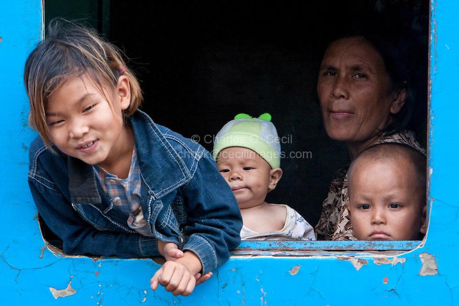 Myanmar, Burma.  Passengers on Train at Kalaw Train Station.