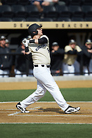 Bobby Seymour (3) of the Wake Forest Demon Deacons follows through on his swing against the Louisville Cardinals at David F. Couch Ballpark on March 18, 2018 in  Winston-Salem, North Carolina.  The Demon Deacons defeated the Cardinals 6-3.  (Brian Westerholt/Four Seam Images)